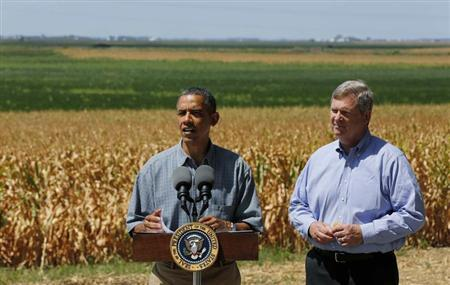 U.S. President Barack Obama talks next to U.S. Secretary of Agriculture Tom Vilsack after they tour the McIntosh family farm with the owners to view drought ridden fields of corn in Missouri Valley, Iowa, August 13, 2012. REUTERS/Larry Downing