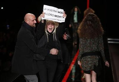 Greenpeace, anti-fur protest confront Milan fashion...