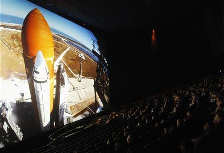 An audience watches ''The Dream is Alive'' film at the IMAX Theater at Smithsonian National Air and Space Museum in Washington April 4, 2012. REUTERS/Gary Cameron