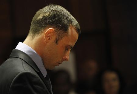 Oscar Pistorius stands in the dock during a break in court proceedings at the Pretoria Magistrates court, February 21, 2013. REUTERS/Siphiwe Sibeko