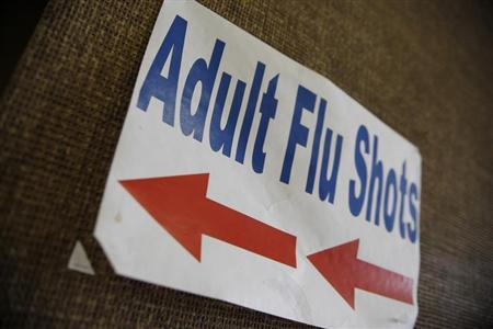A sign advertising adult flu shots adorns the wall inside the Dallas County Department of Health and Human Services building in Dallas, Texas April 24, 2009. REUTERS/Jessica Rinaldi