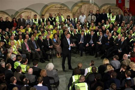 Britain's Prime Minister David Cameron speaks with workers from Prysmian Cables & Systems Ltd during a by-election campaign visit to in Eastleigh, southern England February 21, 2013. REUTERS/Steve Parsons/POOL