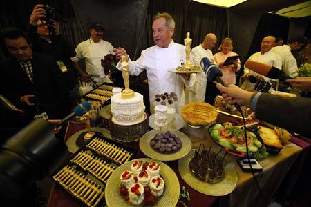 Chef Wolfgang Puck is interviewed during the food and beverage preview for this year's Governors Ball in preparation for the 85th Academy Awards in Hollywood, California February 21, 2013. REUTERS/Mario Anzuoni