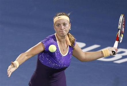 Petra Kvitova of the Czech Republic hits a return to Agnieszka Radwanska of Poland during their women's singles quarter-final match at the WTA Dubai Tennis Championships February 21, 2013. REUTERS/Ahmed Jadallah