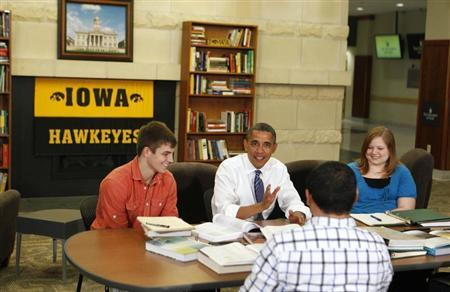 U.S. President Barack Obama speaks to students in a roundtable discussion about the rising costs of student loans while at the University of Iowa in Iowa City, April 25, 2012. REUTERS/Larry Downing