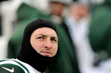 New York Jets quarterback Tim Tebow is on the bench against the Buffalo Bills in the third quarter of their NFL football game in Orchard Park, New York December 30, 2012. REUTERS/Doug Benz