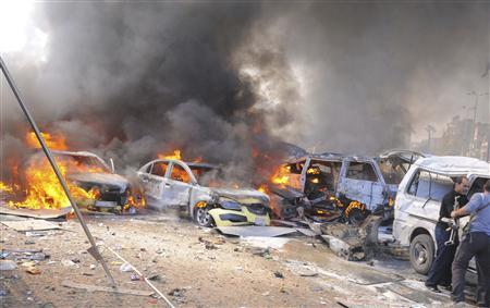 Vehicles burn after an explosion at central Damascus February 21, 2013, in this handout photograph released by Syria's national news agency SANA. The big explosion shook the central Damascus district of Mazraa on Thursday, residents said, and Syrian state media blamed what it said was a suicide bombing on ''terrorists'' battling President Bashar al-Assad. Syrian television broadcast footage of at least four bodies strewn along a main street and firefighters dousing the charred remains of dozens of burning vehicles. Black smoke billowed into the sky. REUTERS/Sana