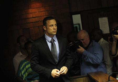 Oscar Pistorius enters the dock during a break in court proceedings at the Pretoria Magistrates court, February 21, 2013. REUTERS/Siphiwe Sibeko