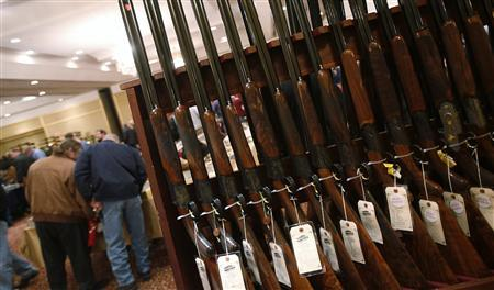 A row of shotguns are seen during the East Coast Fine Arms Show in Stamford, Connecticut, in this January 5, 2013 file photo. REUTERS/Carlo Allegri/Files