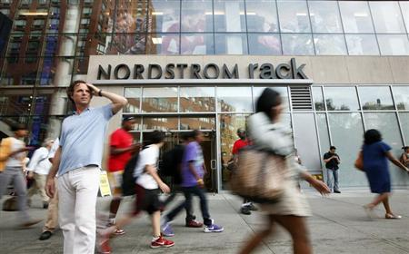 People walk past the Nordstrom Rack store, in New York's Union Square, May 21, 2010. REUTERS/Chip East