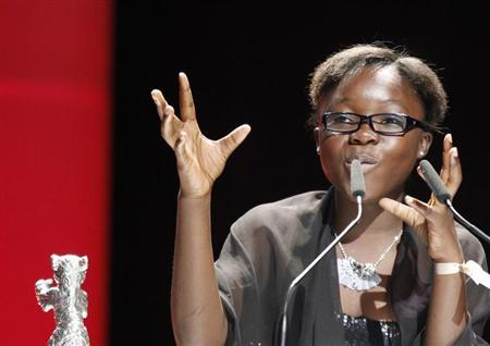 Congo's actress Rachel Mwanza gives a speech after she receives the Silver Bear award for the best actress from actor Jake Gyllenhaal during the awards ceremony at the 62nd Berlinale International Film Festival in Berlin February 18, 2012. REUTERS/Fabrizio Bensch