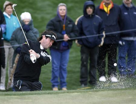 Bubba Watson of the U.S. hits from a sand trap on the second hole during the first round of the WGC-Accenture Match Play Championship golf tournament in Marana, Arizona February 20, 2013. REUTERS/Ralph Freso