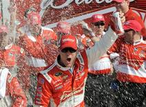 Kevin Harvick celebrates in the victory lane with his crew after winning the first NASCAR Sprint Cup Series Budweiser Duel at the Daytona International Speedway in Daytona Beach, Florida February 21, 2013. REUTERS/Brian Blanco