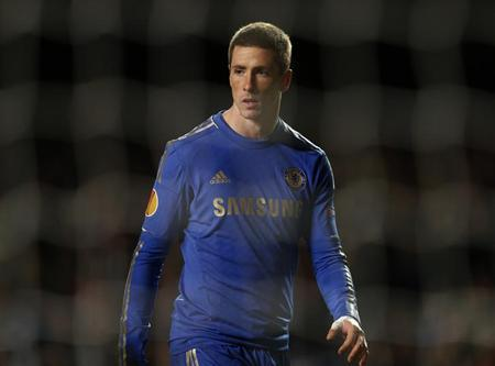 Chelsea's Fernando Torres is seen through the net during their Europa League soccer match against Sparta Prague at Stamford Bridge in London February 21, 2013. REUTERS/Eddie Keogh