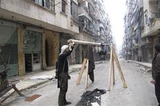 A Free Syrian Army fighter holds an improvised catapult in Aleppo's district of Salaheddine February 19, 2013. REUTERS/Abdalghne Karoof