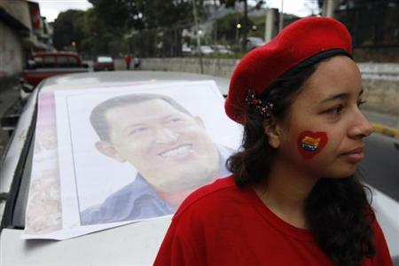 A supporter of Venezuela's President Hugo Chavez stands outside a military hospital, where Chavez is staying at after his surprise return to Caracas February 18, 2013. REUTERS/Edwin Montilva