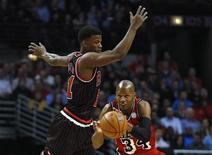 Miami Heat's Ray Allen (R) steals a pass intended for Chicago Bulls' Jimmy Butler during the first half of their NBA basketball game in Chicago, Illinois, February 21, 2013. REUTERS/Jim Young