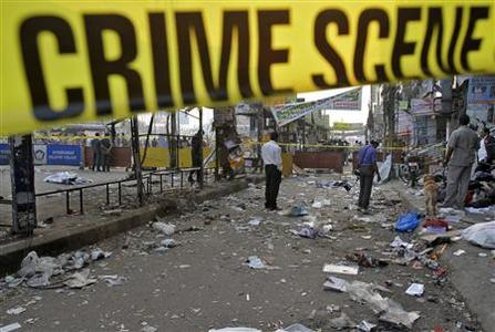 Forensic officials inspect the site of an explosion at Dilsukh Nagar in the southern Indian city of Hyderabad February 22, 2013. REUTERS/Krishnendu Halder