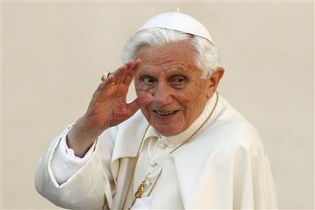 Pope Benedict XVI waves as he arrives to lead the Wednesday general audience in Saint Peter's square, at the Vatican in this October 24, 2012 file photo. REUTERS/Giampiero Sposito/Files