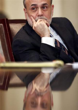 Chairman of the Federal Reserve Ben Bernanke listens during an open meeting of the Board of Governors of the Federal Reserve System in Washington December 14, 2012. REUTERS/Kevin Lamarque (UNITED STATES - Tags: POLITICS BUSINESS) - RTR3BL11