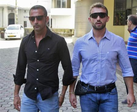 Italian sailors Salvatore Girone (R) and Massimiliano Latorre leave the police commissioner office in the southern Indian city of Kochi January 18, 2013. REUTERS/Sivaram V