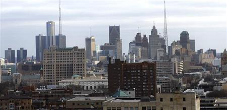 Downtown Detroit is seen through a window from the State Of Michigan offices in Detroit, Michigan February 21, 2013. REUTERS/ Rebecca Cook