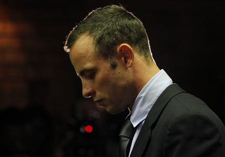Oscar Pistorius stands at the dock before the start of proceedings at a Pretoria magistrates court February 22, 2013. REUTERS/Mike Hutchings