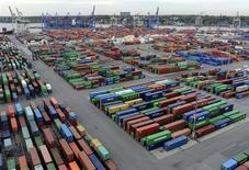 "Containers are seen at the container terminal ""Burchardkai"" of the Hamburger Hafen und Logistik AG (HHLA) in the harbour of Hamburg October 17, 2012. Two years after expanding at its fastest rate since reunification, Germany's economic growth is seen at just 1 percent next year, finally hit by the euro zone crisis that has hammered most of its partners. The government chopped its 2013 growth forecast on Wednesday to 1 percent, down from a 1.6 percent forecast in April. For this year, the economy ministry expects growth of 0.8 percent, up from 0.7 percent in April. Picture taken October 17. REUTERS/Fabian Bimmer (GERMANY - Tags: BUSINESS MARITIME) - RTR399WV"