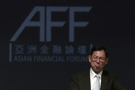 Hong Kong's Chief Executive of Monetary Authority Norman Chan attends the Asian Financial Forum in Hong Kong January 17, 2011. REUTERS/Tyrone Siu