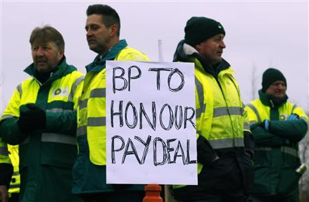 BP tanker drivers picket an entrance to the INEOS Grangemouth oil refinery during a three day strike over cuts to pay and pensions in Grangemouth, Scotland February 22, 2013. BP tanker drivers have begun a three-day strike at Petroineos's Grangemouth refinery in Scotland over a plan to transfer some of them to another employer, which would affect their pensions and pay.REUTERS/David Moir