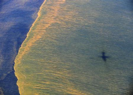 Oil is seen on the surface of the Gulf of Mexico in an aerial view of the Deepwater Horizon oil spill off the coast of Mobile, Alabama, in this handout photograph taken from a U.S. Coast Guard HC-144 Ocean Sentry aircraft on May 6, 2010 and obtained on May 9, 2010. REUTERS/Mass Communication Specialist 1st Class Michael B. Watkins/U.S. Navy/Handout