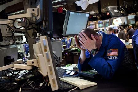 A trader works on the floor of the New York Stock Exchange at the end of the trading day, in New York, April 27, 2012. REUTERS/Andrew Burton