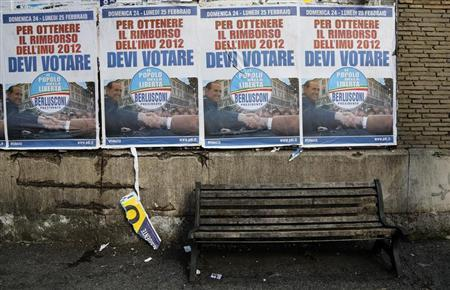 Election campaign posters of PDL (People of Freedom) member Silvio Berlusconi are seen in Rome, February 21, 2013. REUTERS/Stefano Rellandini