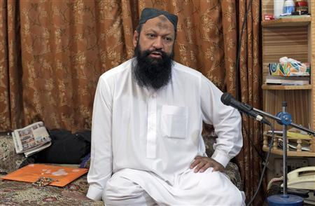 Leader of the Lashkar-e-Jhangvi (LeJ) Malik Ishaq speaks during an interview with Reuters at his home in Rahim Yar Khan in southern Punjab province in this October 9, 2012 file photograph. REUTERS/Mian Khursheed/Files