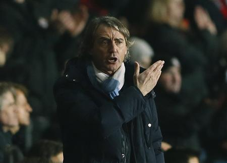 Manchester City's Manager Roberto Mancini reacts during their English Premier League soccer match against Southampton at St Mary's Stadium in Southampton February 9, 2013. REUTERS/Stefan Wermuth