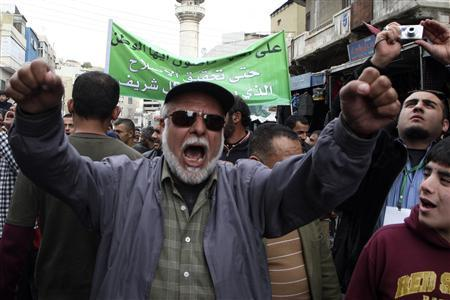 A protester shouts slogans during a demonstration to demand political and economic reforms, and access to corruption cases, organised by the Islamic Action Front and other opposition parties after Friday prayers in Amman February 22, 2013. REUTERS/Majed Jaber