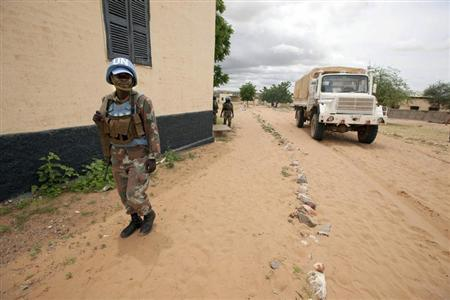 An UNAMID truck, escorted by peacekeepers from South Africa, arrives at the Rural Hospital in Kutum, North Darfur, August 12, 2012. REUTERS/Albert Gonzalez Farran/UNAMID/Handout