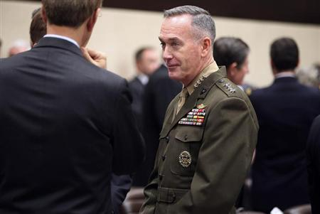 Commander of NATO's International Security Assistance Force (ISAF) and United States Forces-Afghanistan General Joseph Dunford talks with other delegates before a bilateral meeting at a North Atlantic Treaty Organization (NATO) defence ministers' meeting at the NATO headquarters in Brussels February 22, 2013. REUTERS/Chip Somodevilla/Pool