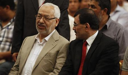 Ennahda movement leader Rachid Ghannouchi (L) speaks with Tunisian Interior Minister Ali Larayedh during the 2nd national congress of the Congress for the Republic (CPR) party in Tunis August 24, 2012. REUTERS/Zoubeir Souissi