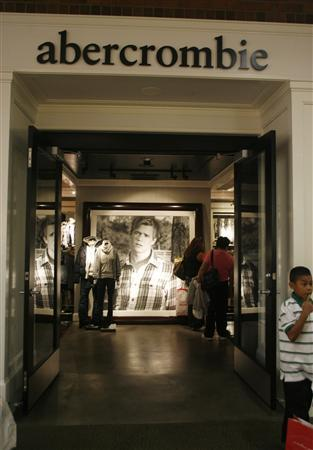A boy stands at the entrance of an Abercrombie & Fitch store at the Glendale Galleria mall in this November 28, 2008 file photo. REUTERS/Fred Prouser/Files
