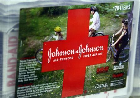 A first aid kit made by Johnson & Johnson for sale on a store shelf in Westminster, Colorado April 14, 2009. Johnson & Johnson said its quarterly earnings fell, hurt by generic competition for its Risperdal schizophrenia drug and the strong dollar, but lower costs enabled the company to beat Wall Street expectations. REUTERS/Rick Wilking