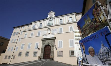 A calendar with a picture of Pope Benedict XVI on its cover is seen in front of his summer residence of Castel Gandolfo, south of Rome, February 21, 2013. On February 28 the pope will take a helicopter to the papal summer retreat at Castel Gandolfo, where he will stay for around two months. REUTERS/Max Rossi