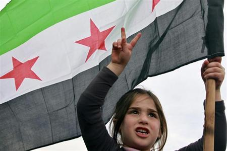 A Syrian girl living in Jordan holds a Syrian opposition flag during a protest against Syria's President Bashar al-Assad in front of the Syrian embassy in Amman February 22, 2013. REUTERS/Muhammad Hamed