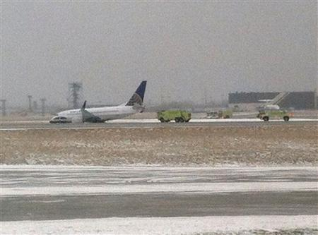 Emergency crews respond to a United Airlines 737 passenger jet after it slid off the runway in icy conditions at Hopkins International Airport in Cleveland, Ohio February 22, 2013. There were no injuries reported, according to local media. REUTERS/Gary Garnet/Twitter