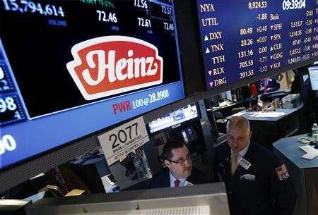 Traders work at the post that trades H.J. Heinz Co. on the floor of the New York Stock Exchange, February 14, 2013. REUTERS/Brendan McDermid