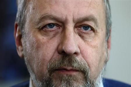 Belarussian dissident Andrei Sannikov listens during an interview with Reuters in London November 1, 2012. REUTERS/Stefan Wermuth