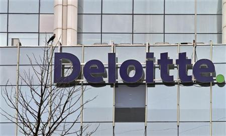 The Deloitte Company logo is seen on a commercial tower at Gurgaon, on the outskirts of New Delhi August 9, 2012. REUTERS/Parivartan Sharma
