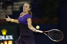 Petra Kvitova of the Czech Republic hits a return to Caroline Wozniacki of Denmark during their women's singles semi-final match at the WTA Dubai Tennis Championships, February 22, 2013. REUTERS/Mohammed Salem