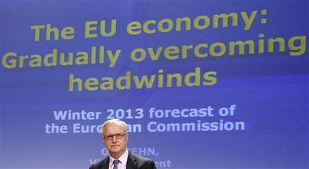 European Economic and Monetary Affairs Commissioner Olli Rehn presents the EU Commission's interim economic forecast during a news conference at the EU Commission headquarters in Brussels February 22, 2013. Several euro zone countries are likely to miss deficit cutting targets because of a weak economy, the European Commission is expected to forecast on Friday, but they may be granted extra leeway rather than face disciplinary action. REUTERS/Francois Lenoir