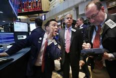 Specialist trader Paul Cosentino (L) gives a price just before the opening bell on the floor of the New York Stock Exchange February 21, 2013. REUTERS/Brendan McDermid (UNITED STATES - Tags: BUSINESS)